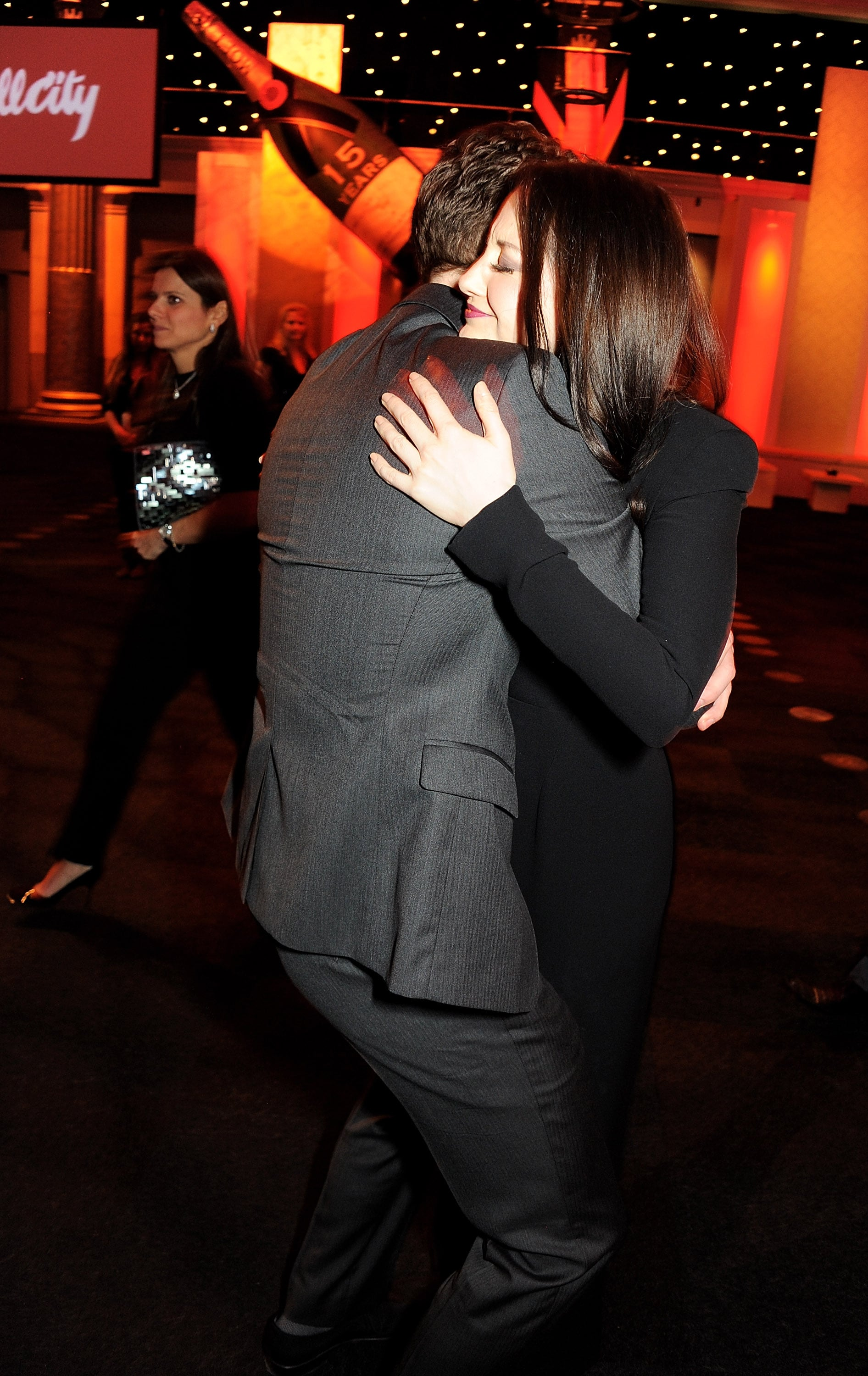 Tom Hiddleston and Andrea Riseborough hugged.