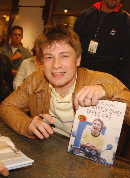 Jamie promoting the launch of his book, The Naked Chef Takes Off, in Toronto in May 2002. Later that year, he opened his first outpost of Fifteen, a restaurant that trains 15 disadvantaged young people to cook, in North London.