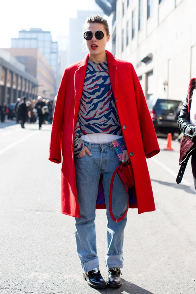A fiery red coat reflected the same bright hues in her animal-print top.