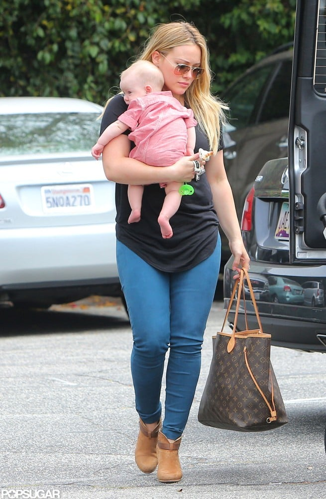 Hilary Duff carried baby Luca Comrie in Santa Monica.
