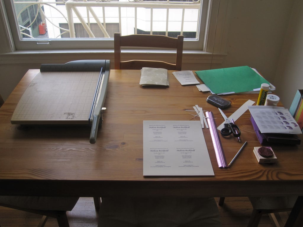 First gather the materials. Here's what you'll need: a computer, printer, nice cardstock, decorative paper, ruler, pencil, eraser, scissors (or other cutting tool), stamp, stamp ink, embossing powder, embossing gun, gluestick, envelopes, nice pen, stamps.