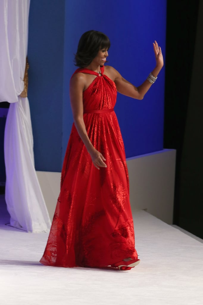 The first lady took to the stage in a sea of Jason Wu red, but paired the look with a wristful of gold bangles.