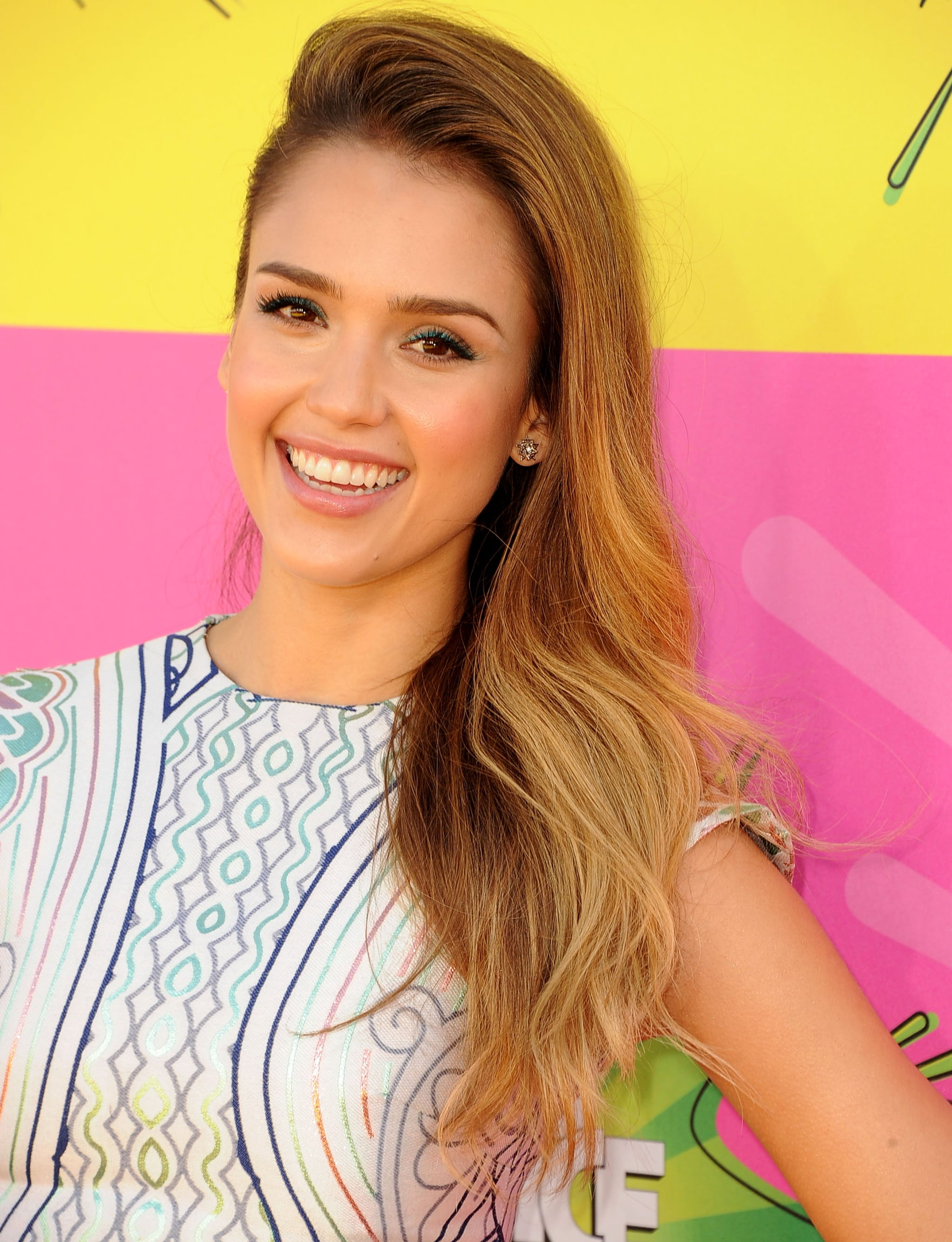 At the Kids' Choice Awards, Jessica Alba slicked back her hair on one side for a sleek over-the-shoulder look.