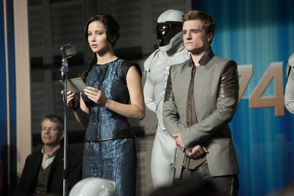 Jennifer Lawrence as Katniss and Josh Hutcherson as Peeta in Catching Fire.