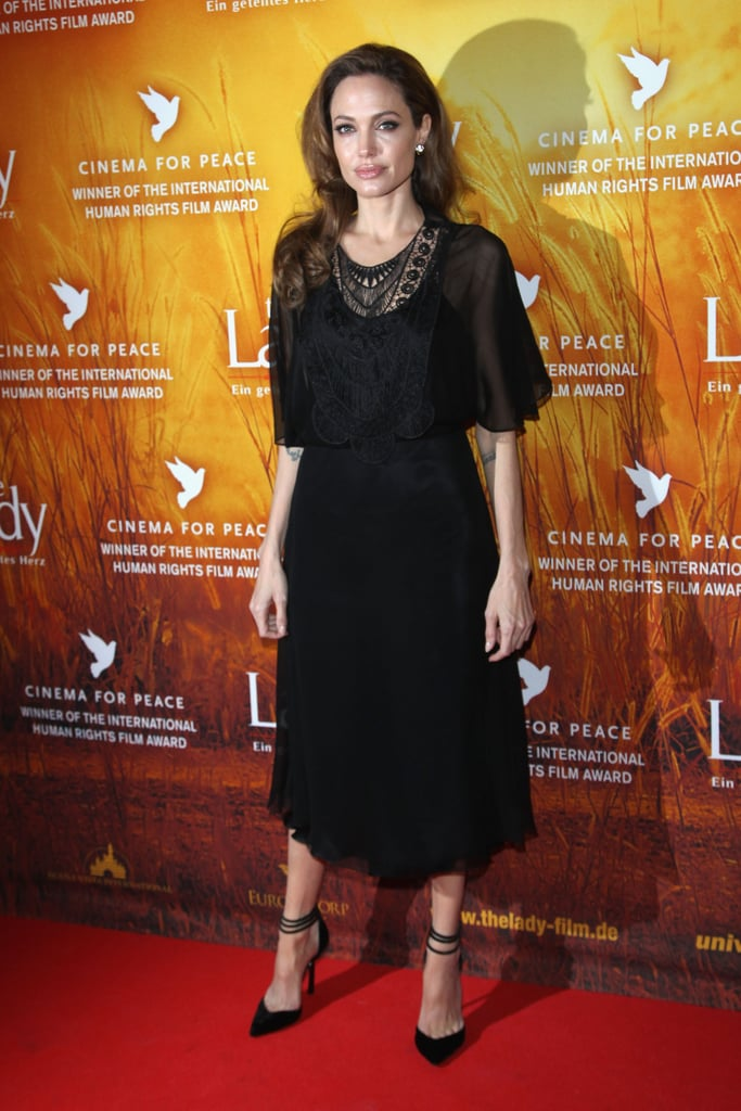 Angelina posed in a black Miguelina dress.