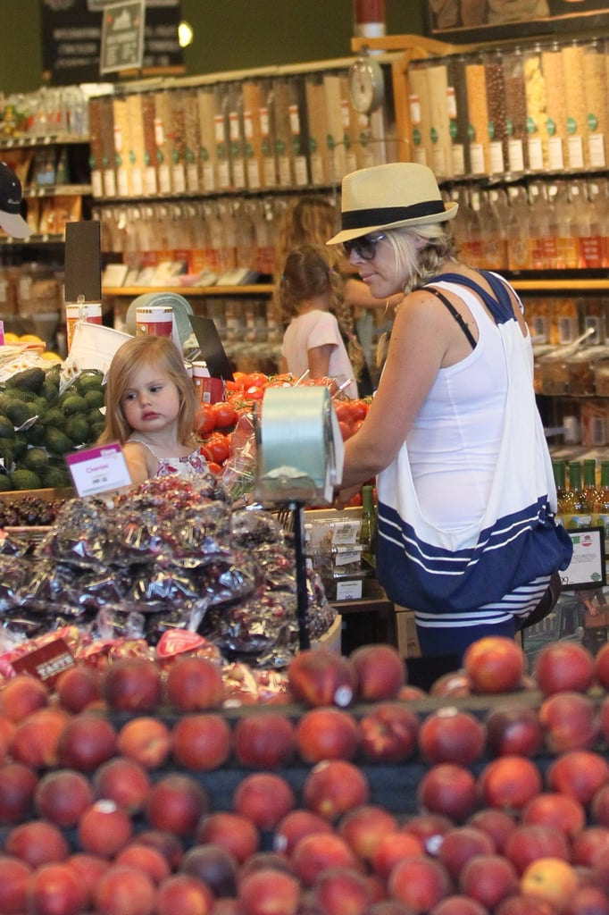 Busy Philipps pushed Birdie around Whole Foods.