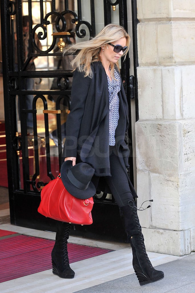 Kate Moss left the Ritz hotel with a bright red bag in tow.