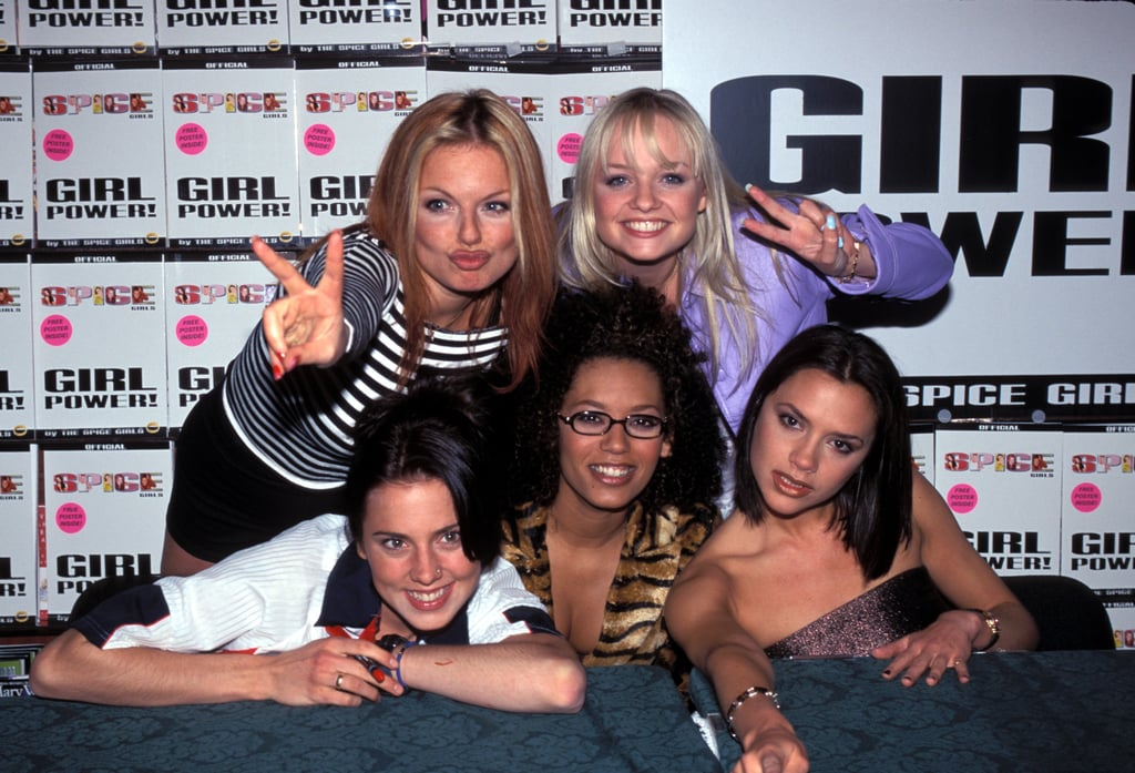The group smiled for photographers and flashed peace signs during their April 1999 book signing in NYC.