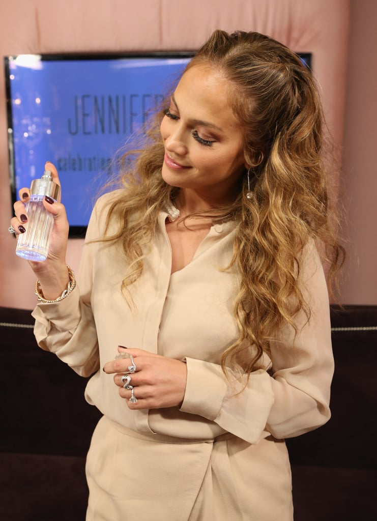 Jennifer Lopez posed with a bottle of Glowing.