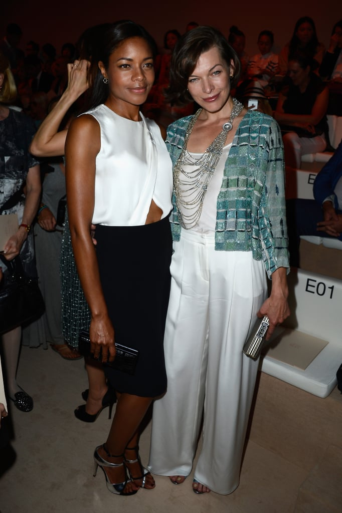 Naomie Harris and Milla Jovovich linked up at the Giorgio Armani Privé show on Tuesday.