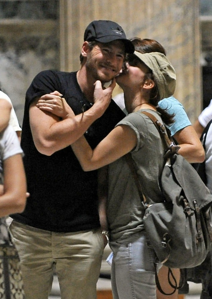 Drew Barrymore planted a kiss on Will Kopelman during their romantic trip to Italy in September 2011.