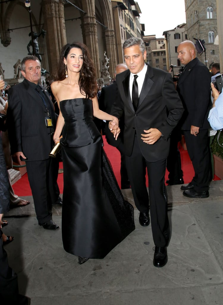 George held Amal's hand on their way into a charity event in Italy in September 2014.