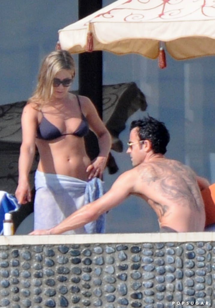 A bikini-clad Jennifer Aniston relaxed with fiancé Justin Theroux during a getaway to Cabo.