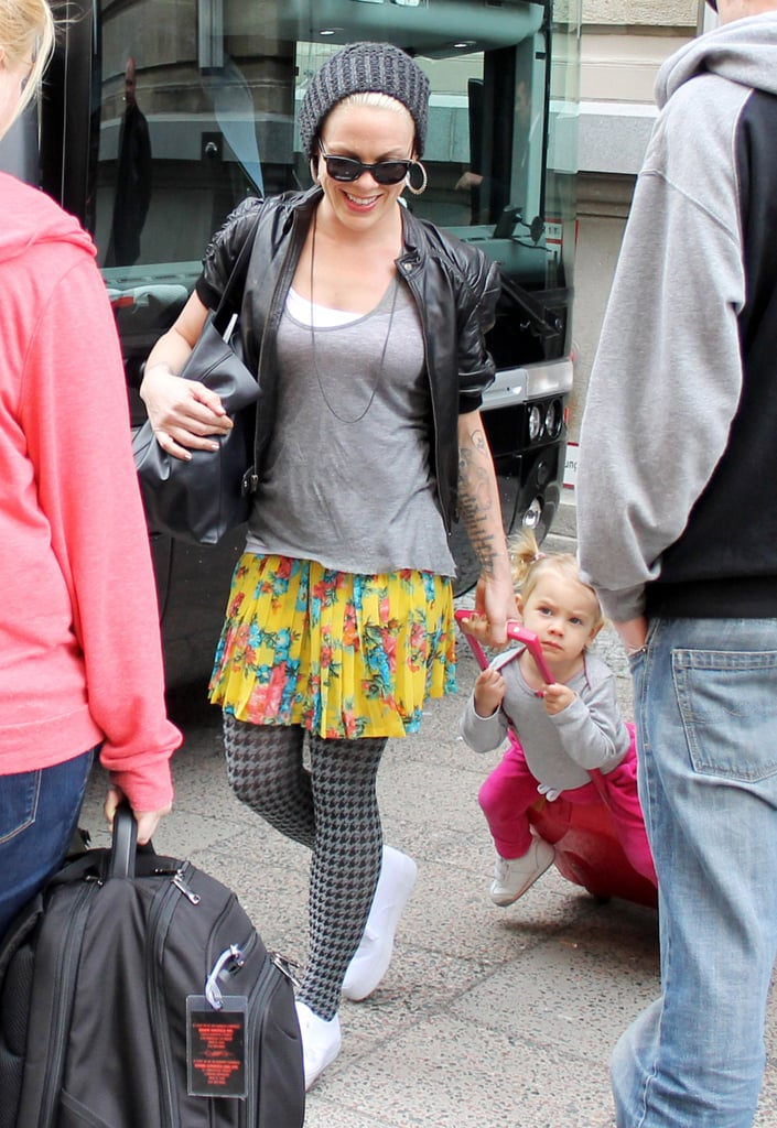 Pink and her daughter, Willow Hart, arrived at their hotel in Berlin as Willow rode her luggage through the crowd.