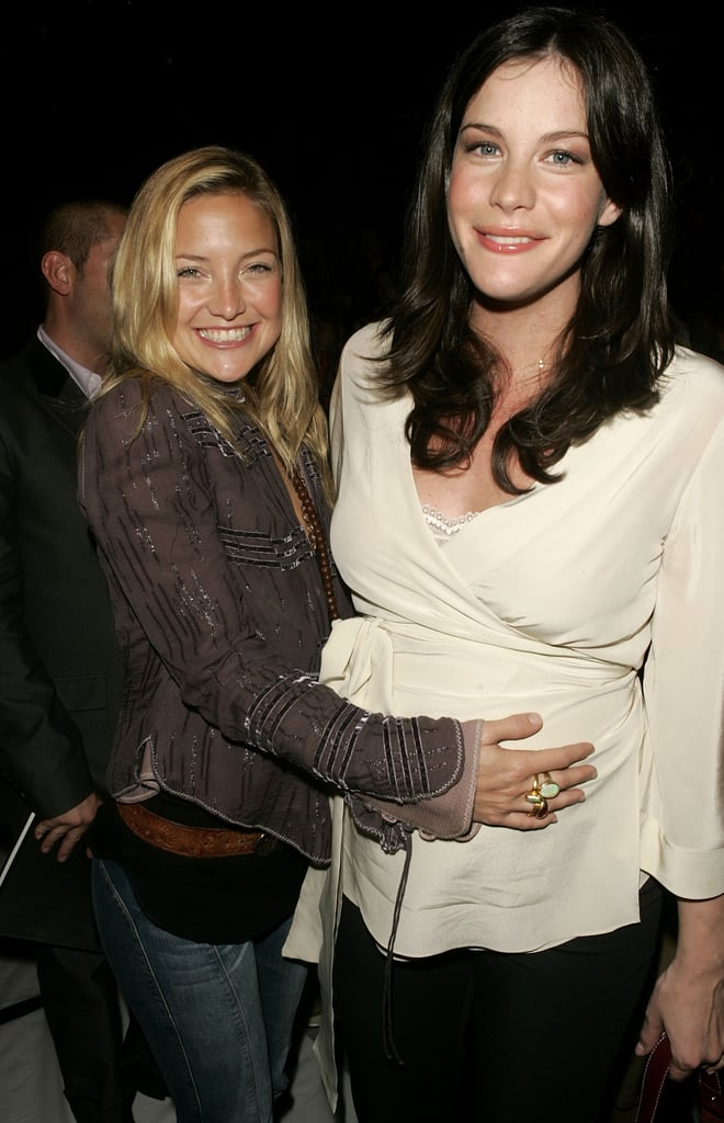 Kate Hudson and then-pregnant Liv Tyler snapped a sweet pic at the Marc Jacobs September 2004 show.