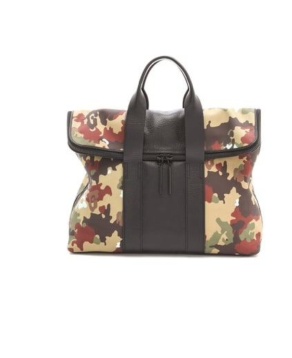 We can think of few carryalls with as much personality as this 3.1 Phillip Lim canvas 31 Hour bag ($595).
