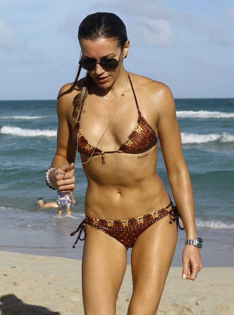 In December 2015, Katie Cassidy gave photographers a peek at her killer abs in a sexy bikini.