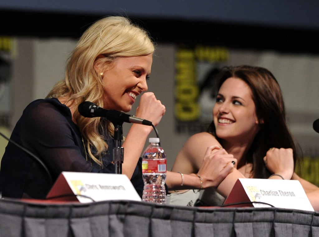 Charlize Theron and Kristen Stewart joked around during the Snow White and the Huntsman panel discussion in 2011.