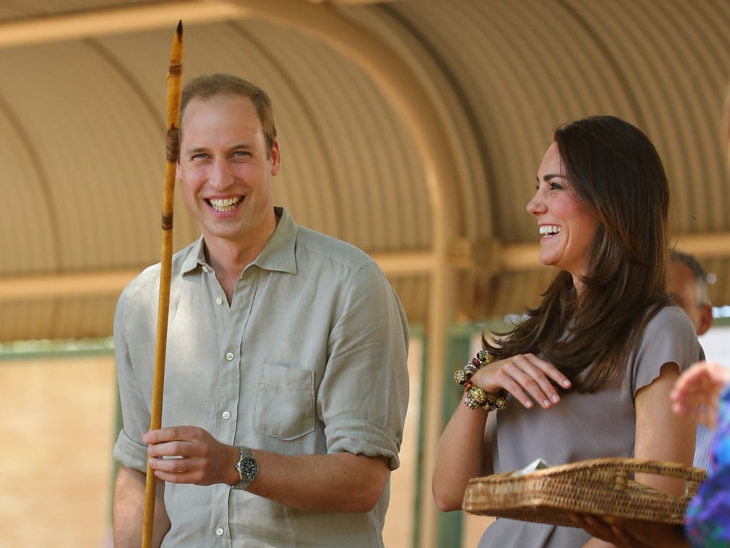 Kate laughed with Will as he held an Aboriginal spear at the National Indigenous Training Academy in Ayers Rock, Australia, during their 2014 tour.
