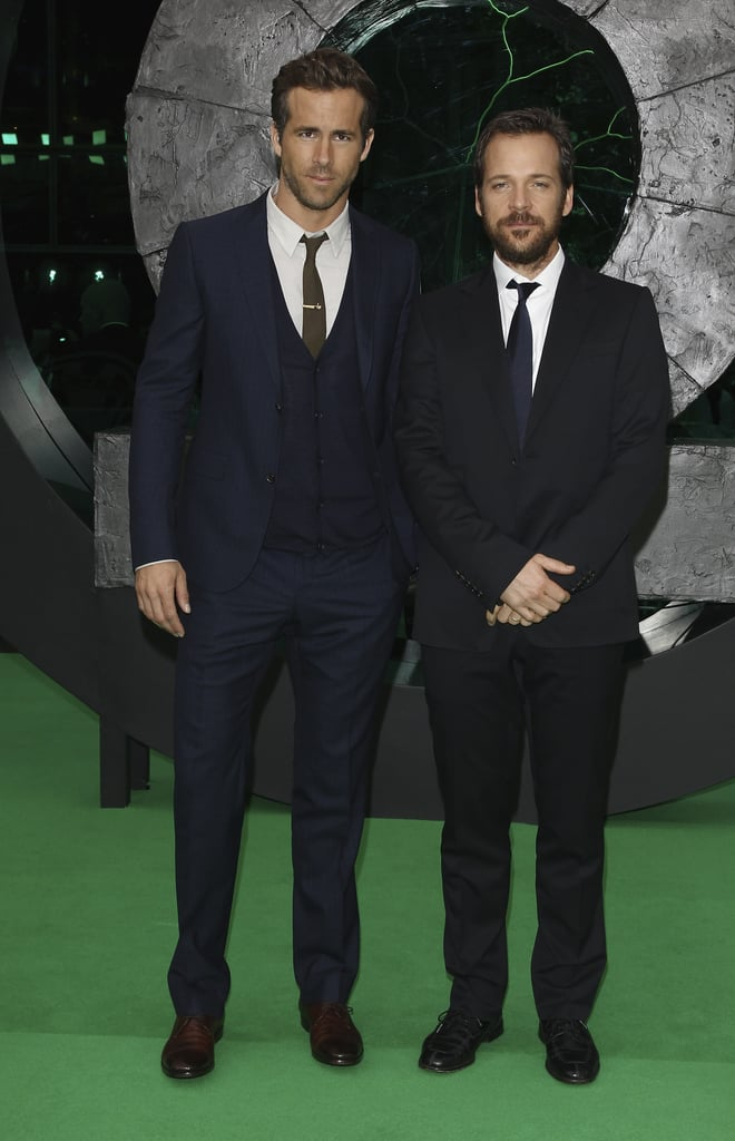 Ryan Reynolds and Peter Sarsgaard posed on the green carpet.