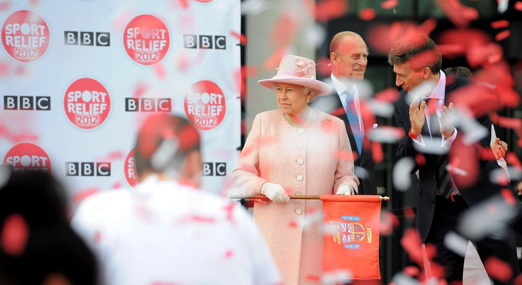 The queen looked on after waving the flag to officially start the Sport Relief 2012 fun run in Salford.
