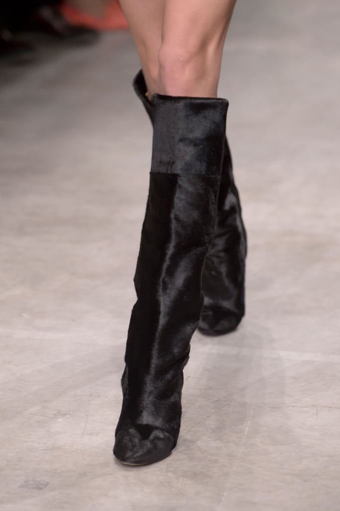 The brand went high, too, with tall boots in gleaming calf hair that extend to just below the knee.