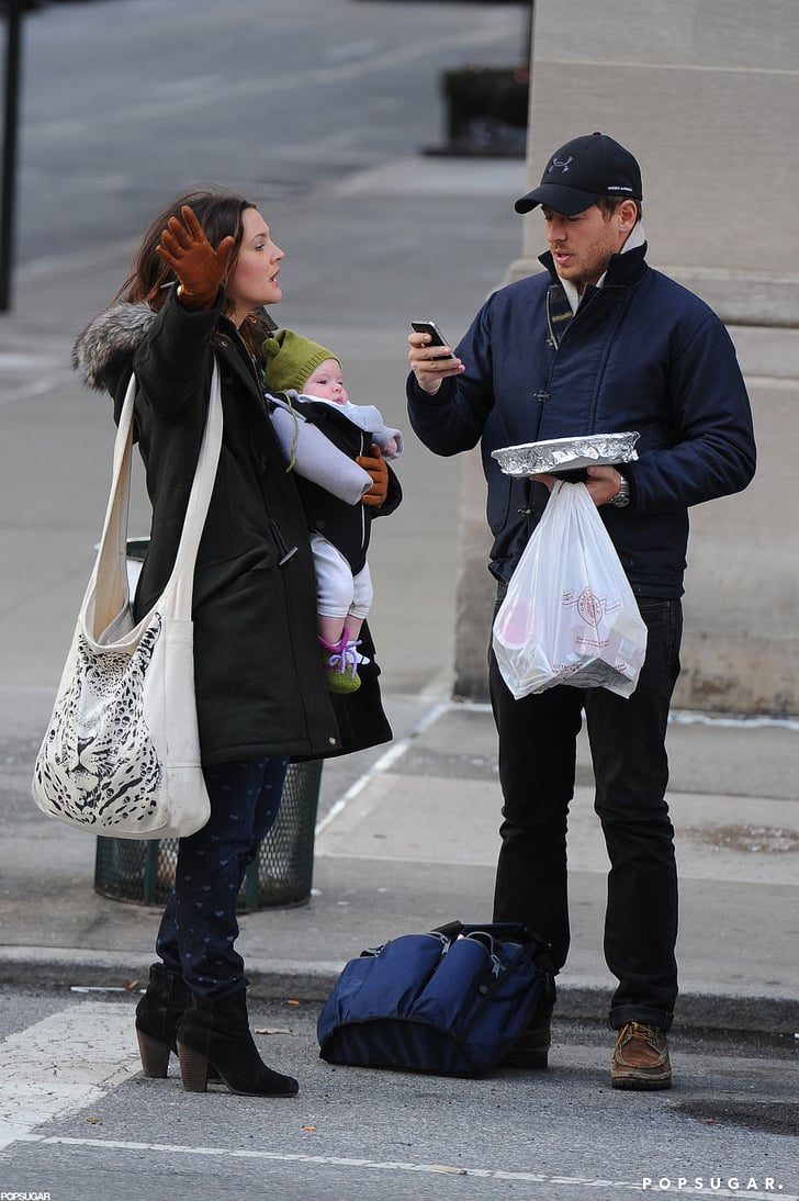 Drew Barrymore hailed a cab in NYC with her husband, Will Kopelman, and daughter, Olive.