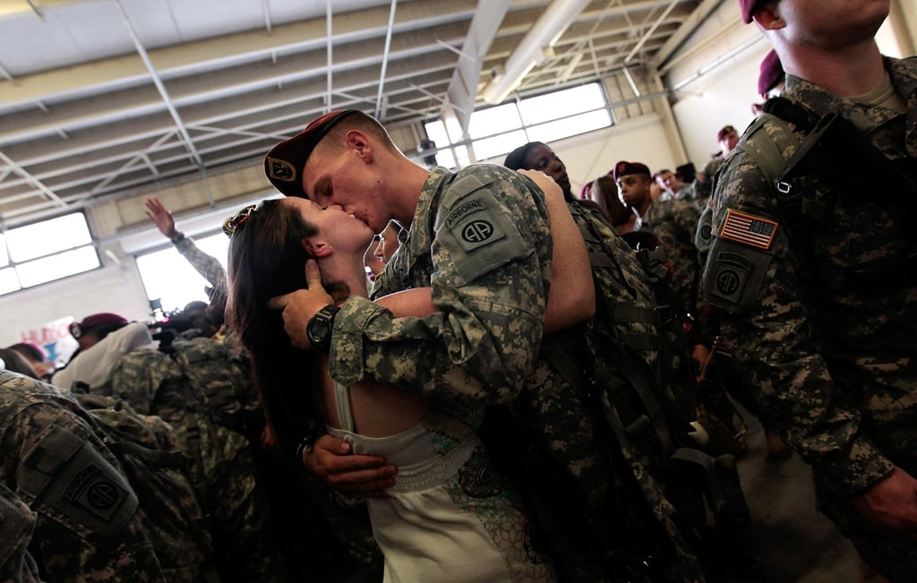 Sgt. Patrick Hopkins embraced his fiancée, Cara Benz, when he returned from a yearlong tour in Iraq with the US Army's 82nd Airborne Division on July 30, 2010, in Fort Bragg, NC.