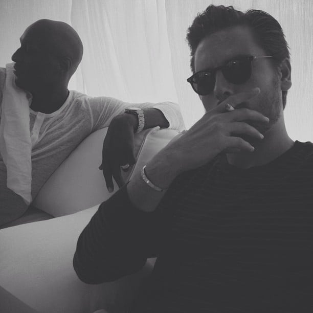 Khloé Kardashian snapped a picture of Scott Disick and her husband, Lamar Odom, at Kim Kardashian's baby shower. Source:Instagram user KhloeKardashian