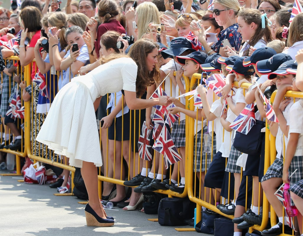 Kate Middleton chatted with her younger fans while in Singapore.