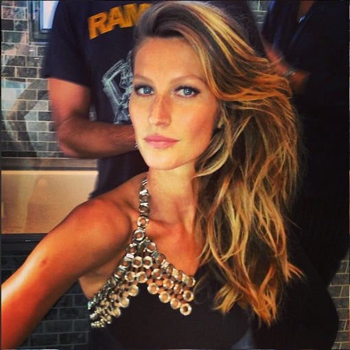 Gisele Bundchen shared a close-up of her hair, makeup, and beautiful Anthony Vaccarello mini. Source: Twitter user giseleofficial
