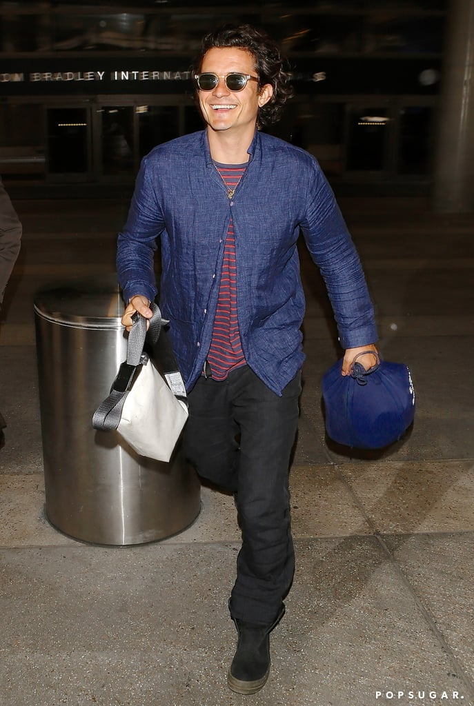 Orlando Bloom smiled at LAX on Tuesday.