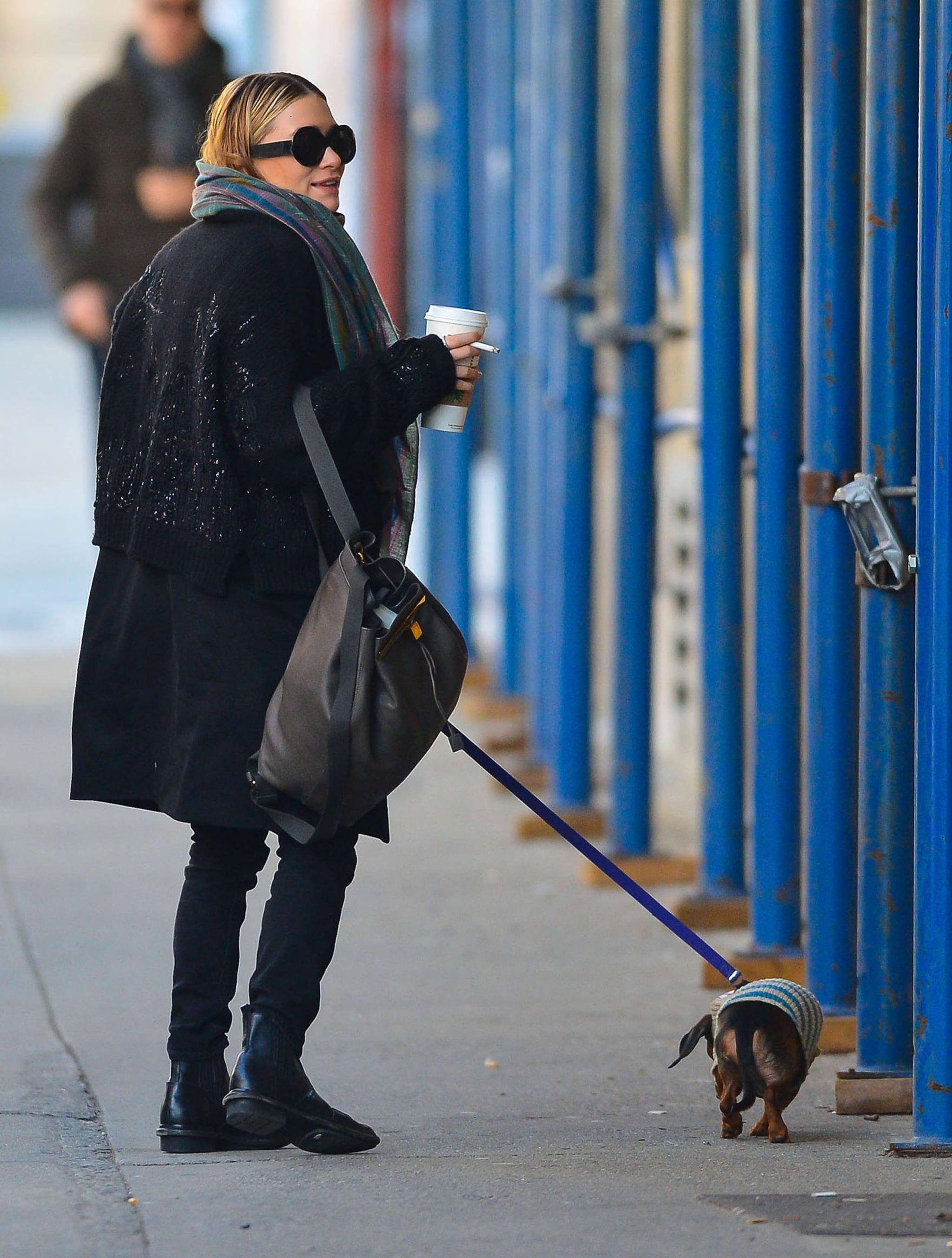 Ashley Olsen sipped on coffee while walking her dog.