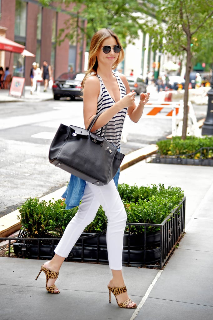 Miranda Kerr Wearing a Denim Shirt and Leopard Heels