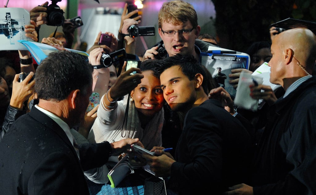 Taylor Lautner poses with fans at the Abduction premiere in London.