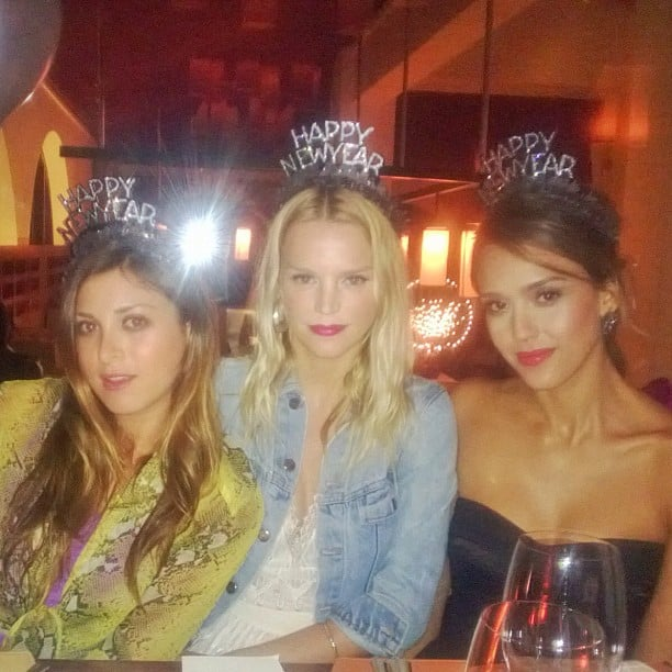 Jessica Alba posed in a party hat with friends. Source: Instagram user jessicaalba