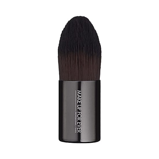 Foundation brushes are a dime a dozen, except when it comes to Make Up For Ever 102 Small Foundation Kabuki ($36). It's dense enough for seamless application, allowing you a streak-free finish on your foundation. But unlike typical kabuki brushes, it has a tapered edge, which gets into the nooks and crannies around your eyes, nose, and lips. The best part about Make Up For Ever's brush is that it's good with cream or liquid foundation, so you can use it all year round. — MD