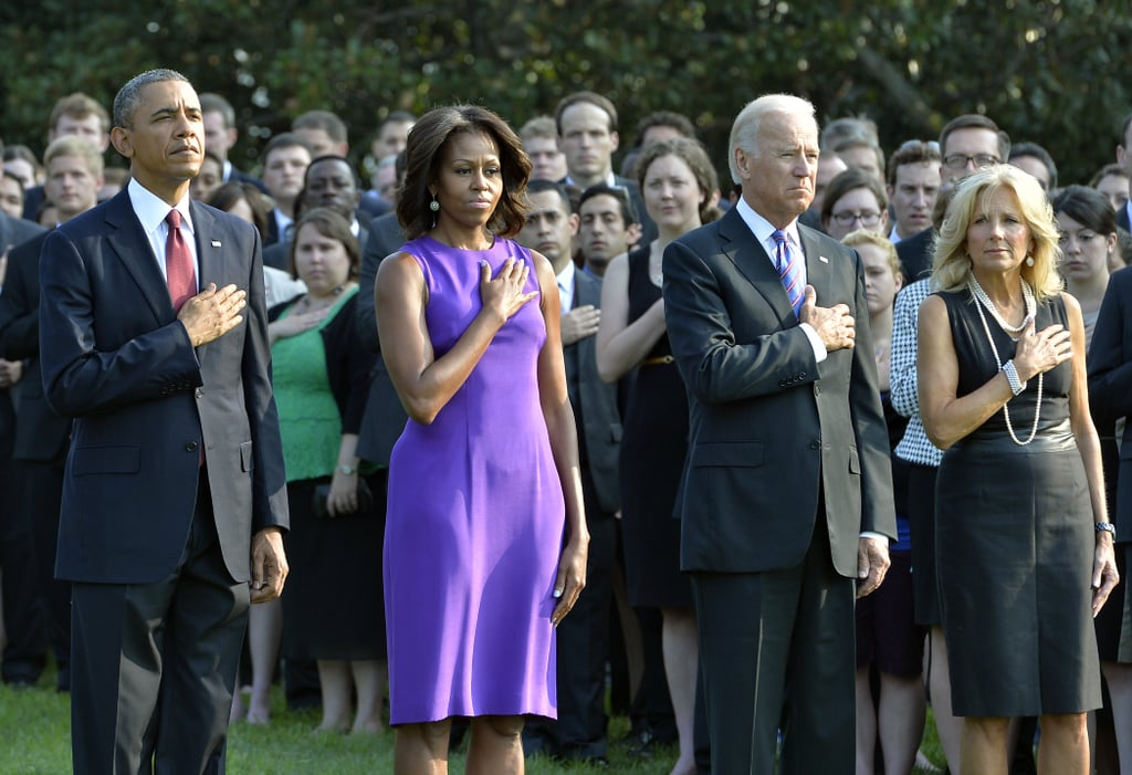 The group put their hands on their hearts during the moment of silence at the White House in Washington DC.