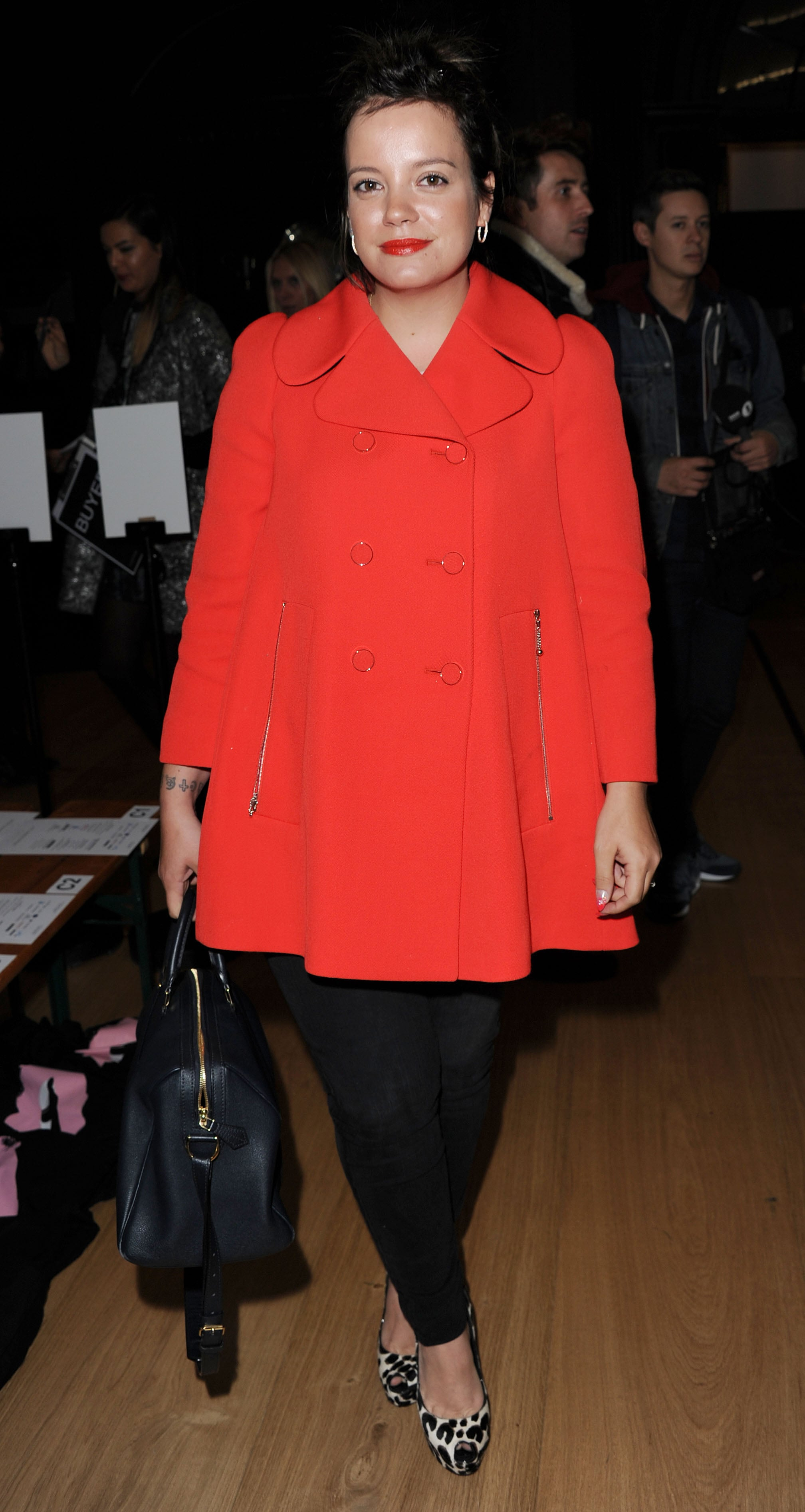 Lily Allen brightened up the front-row scene at the Giles show in a bold red coat and leopard pumps.