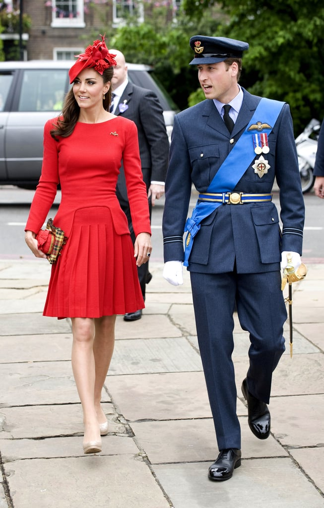 The royal couple made a regal arrival, with Prince William in his flight lieutenant ensemble and Kate in complementary statement red.