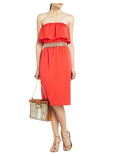 With the right accessories, this little dress could go just about anywhere. We love the way it's styled here, with a metallic belt and sandals to polish off its breezy shape.  BCBG Max Azria Malia Ruffled Strapless Cocktail Dress ($158)