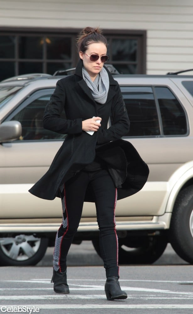 Olivia stepped out in a flared black peacoat, print-paneled Rag & Bone leggings ($286), black ankle boots, classic aviators, and a ribbed scarf.  9141076