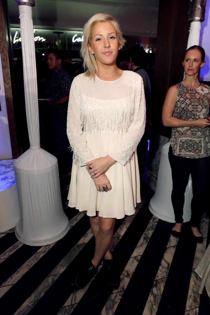 Ellie Goulding was spotted inside the Topshop LA party in a girlie long-sleeved white dress and minimal makeup.