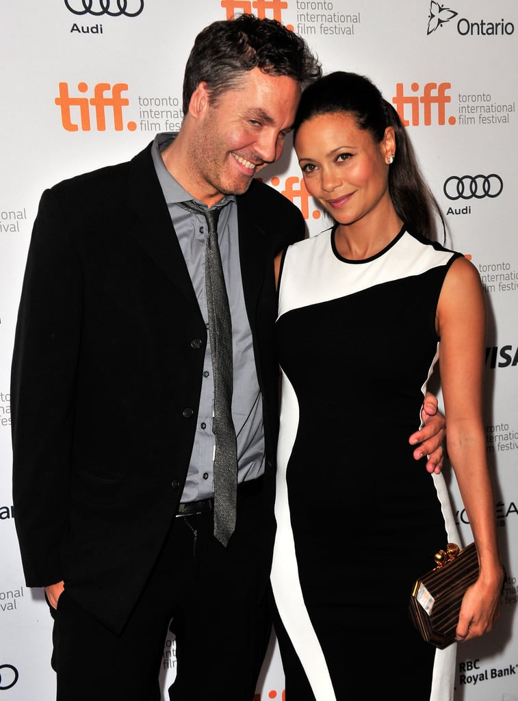 Thandie Newton cosied up to her husband, Ol Parker, after announcing her third pregnancy at the Half of a Yellow Sun premiere.