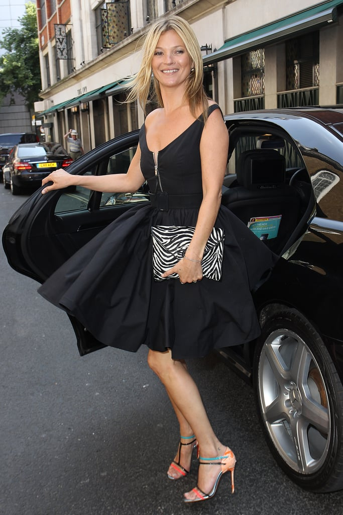 Part Audrey Hepburn, part bombshell, Kate Moss was out and about in London in a black fit-and-flare dress and multicolored heels.