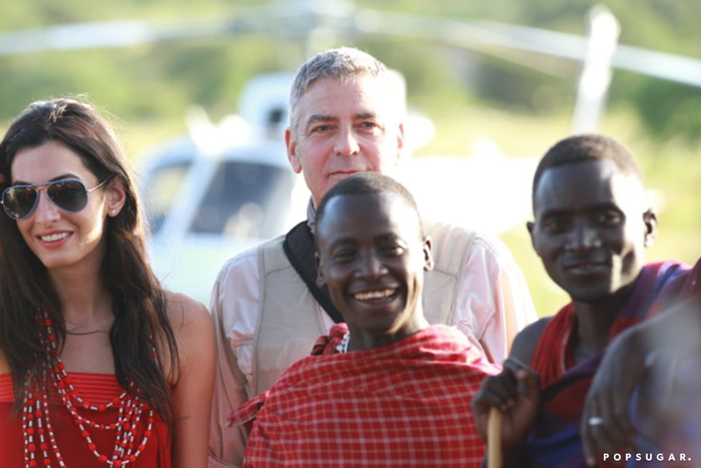 The couple posed with locals during an outdoor trip in Tanzania in March 2014.