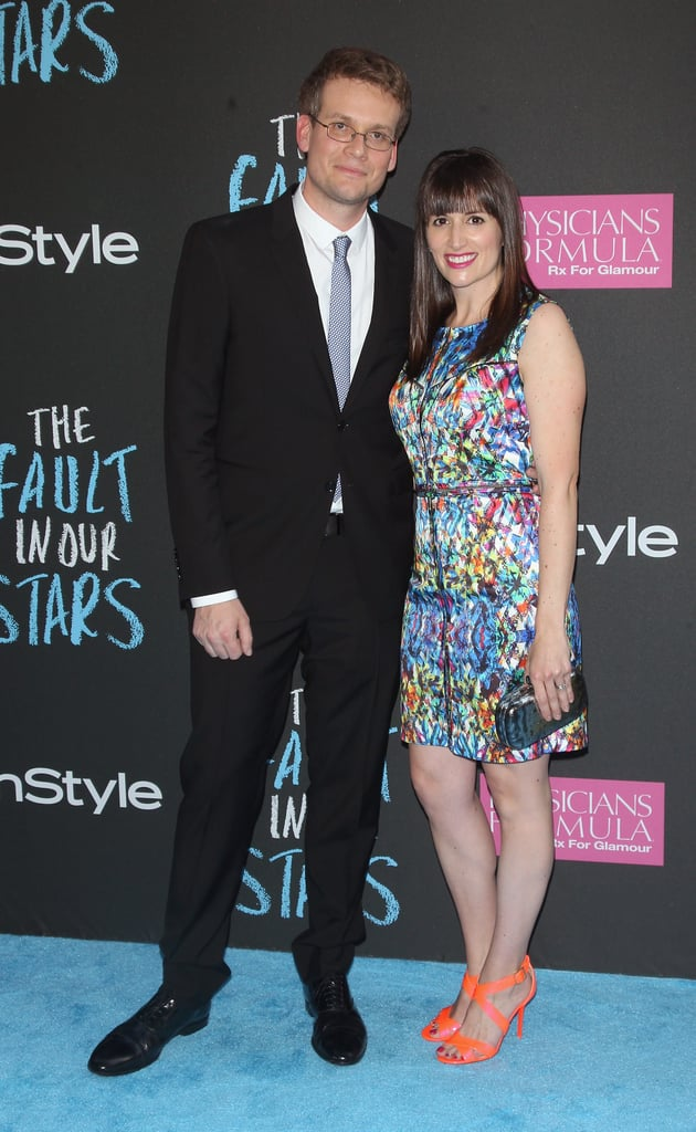 "John Green (pictured with his wife, Sarah Urist) loved the whole film, but there was one scene he think came out particularly perfect. ""I think they did a great job with the love scene,"" he revealed on the blue carpet. ""It's so beautiful."""