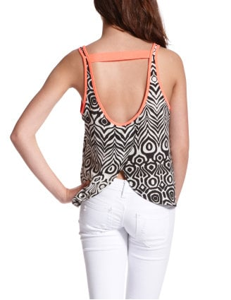 Tribal print, neon pops of color, a tapered back hem — this top simply screams Summer.  Charlotte Russe Pop Color Tribal Tank ($20)