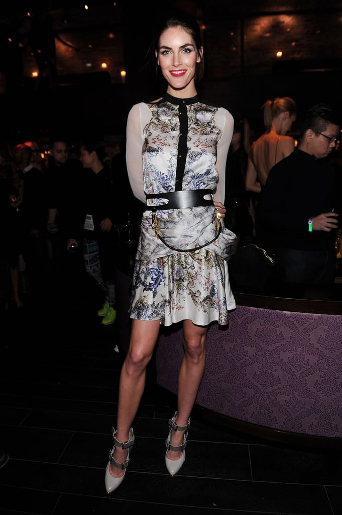 Hilary Rhoda accessorized her new engagement ring with a printed dress with leather detailing.