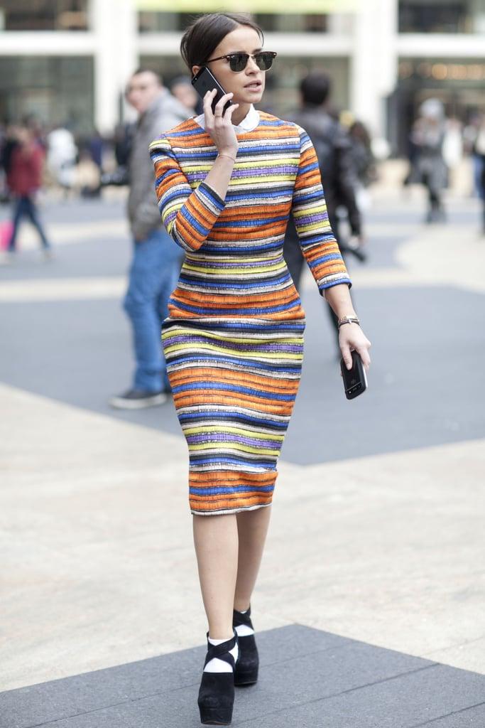 Miroslava Duma showed off her stripes in a fitted, multihued sheath.